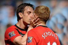 footballers kissing