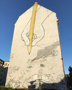 The famous graffiti artist Blu from Italia made the painting in 2008 in Aarhus - I never knew it was him before I saw other paintings in Berlin. Look at the way he merged the rubber on the yellow pen and the chimney #aarhus #mitaarhus #denmark #visitdenmark #visitaarhus #blu #graffittiart #art #wallart