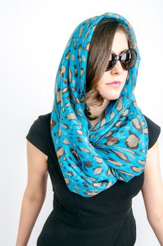 Just call her Jenna-O. Jenna dons her blue infinity scarf and sunglasses in the style of fashion icon Jackie O.