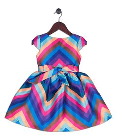Give her a standout look with this vibrant dress featuring bold chevron stripes and delightful bow accents.100% polyesterHand washImported