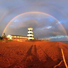 Rainbow over West Point Lighthouse in Prince Edward Island