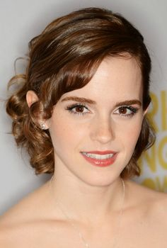Emma Watson makes curled bangs cute! Soft curls make for a neat yet relaxed, elegant look.