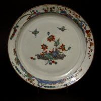 KANGXI or YONGZHENG c.1700 -1730 Dutch Decorated Chinese Export PorcelainA Late Kangxi or Early Yongzheng Porcelain Plate c.1700-1730. Entirely Decorated in Holland c.1720-1730 in the Kakiemon Style with Birds Flying Above a Flowering Plant in Between Two Banded Hedges. The Border with the `Three Friends of Winter`. R and G McPherson dealers in antique Chinese porcelain.