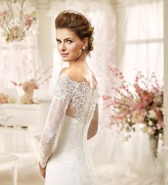 Lace gowns, beautiful back, illusion back  206-432-9383