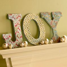 wood letters covered with scrapbook papers or wrapping paper