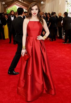 Hailee Steinfeld in a pleated Michael Kors gown in red and matching lip at the 2015 Met Gala