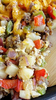 Skillet Sausage Hash with Eggs~ perfectly cooked fresh potato cubes, spicy peppers, fluffy eggs, gooey cheese, and of course: sausage!