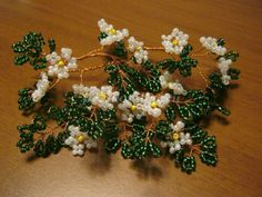 Flowering branch of apple beads. Master class