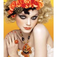 I just love everything about this - hair, makeup, flowers, orange... yay!