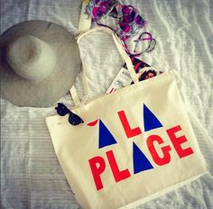 A La Plage beach tote bag