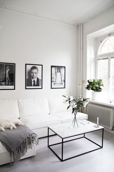 White marble coffee table with black base in Minimalist living room