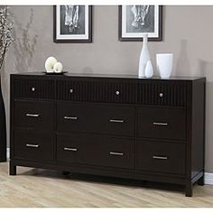 This dresser & it's accompanying pieces to go with the tramp bed.  Love it all. @Overstock - This functional 9-drawer dresser is made from rubberwood in dark Halifax brown finish. Rippled accents on the drawers and brushed silvertone hardware lend an elegant look to this Wavelength dresser.http://www.overstock.com/Home-Garden/Wavelength-9-drawer-Dresser/3250426/product.html?CID=214117 $576.71