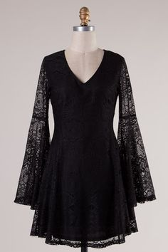 "- Black lace bell sleeve dress with back zipper - Lace: 100% Polyester. Lining: 100% Polyester - 31"" Shoulder to Hem - Runs small"