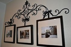 Wrought iron picture hanger with upcycled frames. Put to better use ...