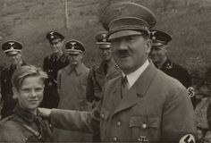 A young German boy wears his father's uniform, 1939. Description from pinterest.com. I searched for this on bing.com/images