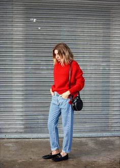 bright red sweater, straight leg jeans, black bag and shoes, medium length hair