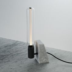 A Victorian night-light for the 21st century, this Buster + Punch LED table light emits a warm and ambient glow harkening back to an era of candle light.