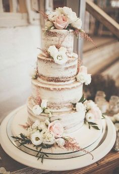 Brides.com: . A nearly-naked rustic wedding cake by Sweet Thought Cakes with