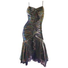 1970s Samir Rainbow Metallic Asymmetrical Lace Hem Vintage 70s Disco Dress | From a collection of rare vintage cocktail-dresses at https://www.1stdibs.com/fashion/clothing/evening-dresses/cocktail-dresses/