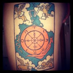 Wheel of Fortune Tarot Card tattoo. Done at Planet NY Tattoo in Poughkeepsie, NY