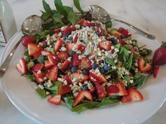 Spinach salad with toasted pecans, blueberries, strawberries and blue cheese. Top with your choice of grilled chicken or shrimp and a raspberry vinaigrette.