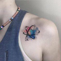 Atom tattoo on the left shoulder.