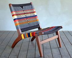 Woven Manila Hammock Chair San Geronimo design.   Features an alternating colorful stripe pattern and a sustainably sourced Rosita Walnut frame. Also available in Teak & Royal Mahogany. The handwoven seat and back is remarkably firm, comfortable, and sturdy.   All of the wood used in our products is either reclaimed from hurricane damaged areas or sustainably harvested.