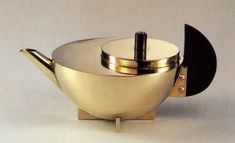Marianne Brandt (German, 1893-1983), Tea infuser and strainer, c. 1924, Silver and ebony. Height: 7.3 cm.