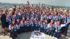 Great Britain's medal winners pose on the roof of Team GB House in Stratford, London