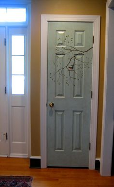 Love the Green Door but the Painting of the Branch and Bird is Fantastic