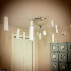Make paper candles to hang from the ceiling. To make these, roll white printer paper into a tube and secure with tape.