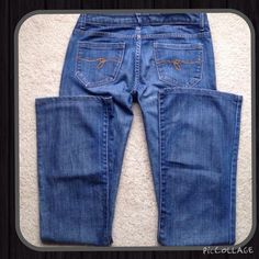 """Guess Belmont Flare Jeans, Size 27 Guess Belmont Flare Jeans, Size 27, true waist 28"""", inseam 32"""", rise 7"""", says flare but fits more like Bootcut, slight wear on left rear hem only, ✅ bundle discounts only ✅ pet and smoke free home  trades Guess Jeans Flare & Wide Leg"""