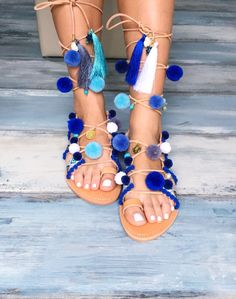 Bohemian sandals Delphinium Greek leather by PinkyPromiseAccs. They are decorated with blue & white ribbon, semiprecious stones (such as turquoise, pearls, agate, howlite, aquamarine beads), gold plated coins, tassels and pom pom!