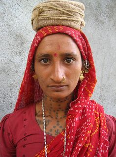 Meena Khadri - lady in Red, village labourer in Diu, India
