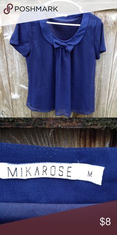 Mika rose blouse Like new. Mikarose blue bow blouse. Has sheer fabrication but not see through. Some pulling of thread on its sheer fabrication, other than that this is like new mikarose Tops Blouses