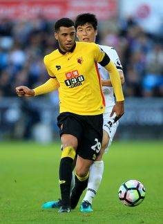 Etienne Capoue of Watford and Ki Sung-Yueng of Swansea City compete for the ball during the Premier League match between Swansea City and Watford at the Liberty Stadium on October 22, 2016 in Swansea, Wales.