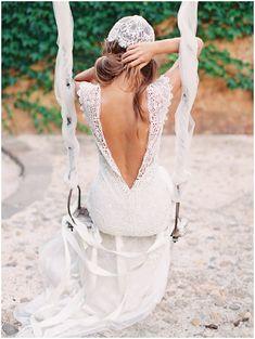 bride with low back lace wedding dress on romantic swing with lace cap veil via www.frenchweddingstyle.com #weddingdress
