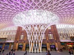The historic section of King's Cross was designed by architect Lewis Cubitt and completed in 1852. At the time, its two train sheds' glass roofs were considered cutting-edge, although their laminated timber beams were replaced with steel girders, and their two platforms and 14 tracks quickly fell short of demand. A new edge has been honed with a 15-year, $650-million renovation project that has as its most prominent feature a new concourse designed by John McAslan (pictured). Covering a new…