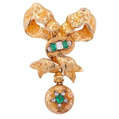 Georgian Emerald Diamond Gold Bow Brooch | From a unique collection of vintage brooches at http://www.1stdibs.com/jewelry/brooches/brooches/