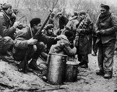 Madrid, Spain. Republican Soldiers eating. By Robert Capa, (November-December 1936)