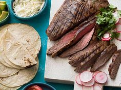 Grilled Tequila Garlic Lime Flank Steak recipe from Guy Fieri via Food Network