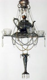Pretty repurposed silver teapot and crystal glasses into awesome chandelier