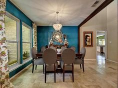Blue dining room walls with natural lighting and tile floors 1805 Congressional Circle, Austin, TX 78746