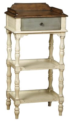 This hand painted distressed weathered ivory finish accent table features one functional drawer and two shelves. The table offers antique brass finished hardware. Materials: Hardwood and MDF Finish: H Round End Tables, End Table Sets, Sofa End Tables, End Tables With Storage, Painted End Tables, Metal End Tables, Glass Side Tables, Pulaski Furniture, Painted Furniture
