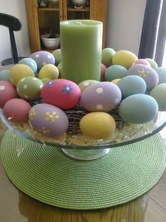 "My easy Easter centerpiece - cake stand, inexpensive egg wreath, pillar, ""grass"" and placement.  All items purchased at Christmas Tree shops (except the cake stand, which I already had)."