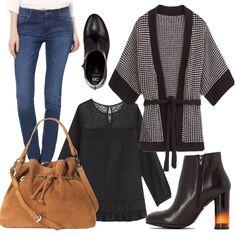 Outfit particolare. Stivaletto splendido con parte del tacco arancione che si vede con il jeans stretch. Ho scelto poi una deliziosa camicetta nera da abbinare allo splendido kimono in bianco e nero. La borsa è scamosciata beige per spezzare il tutto. Look da lavoro e da passeggio.