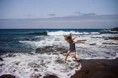 5 steps to improve the light in your photos right now pic of kid jumping in the waves by Anita Perminova