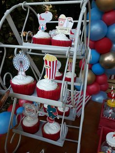 Take a look at the cute Ferris wheel cupcakes at this Circus Vintage Birthday Party! See more party  ideas and share yours at CatchMyParty.com #catchmyparty #partyideas #circusparty #circuscupcakes