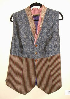 Diane Ericson Design.  Here is a vest created with a combination of vintage Kimono textiles and linens. I cut the neck edge  in a 'V' then made a bias cut collar in 2 layers to enhance the neckline.