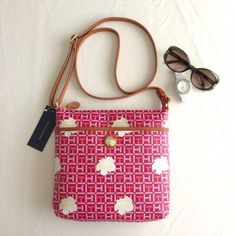 """HP TH crossbody bag Authentic Tommy Hilfiger crossbody; pink coated canvas (easy to clean/wipe-off) with signature TH logo, off-white flowers, and brown leather trim and strap (adjustable); measures approx. 10.5"""" wide x 9"""" high x 1.5"""" deep Tommy Hilfiger Bags Crossbody Bags"""